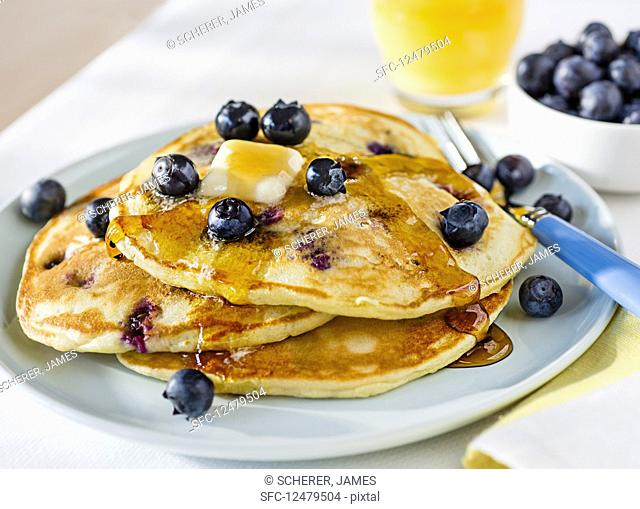 Pancakes with blueberries, butter and syrup