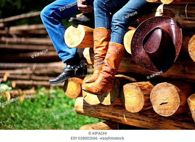 Men's and women's cowboy boots, jeans and hat
