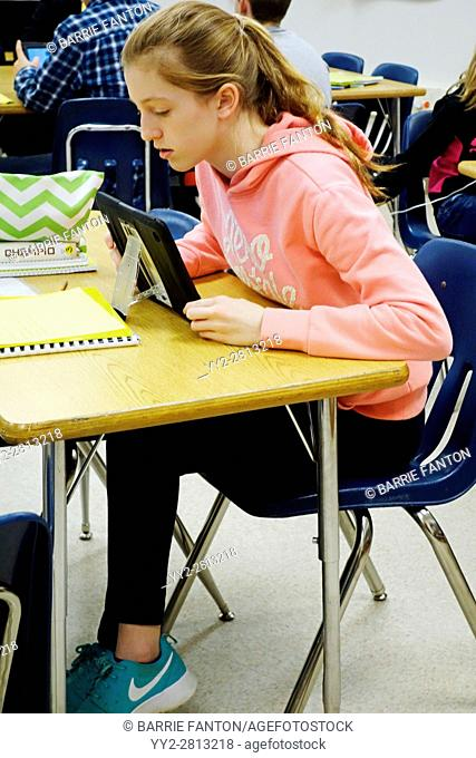 7th Grade Girl Concentrating on iPad Lesson, Wellsville, New York, USA