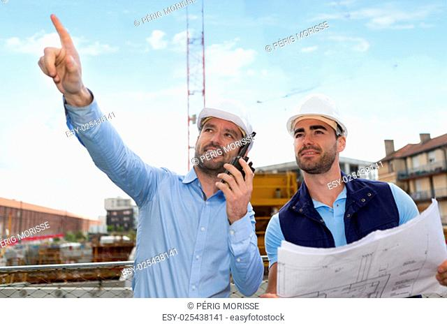 View of a Worker and architect watching some details on a construction
