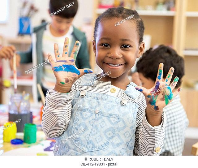 Student with messy hands in classroom