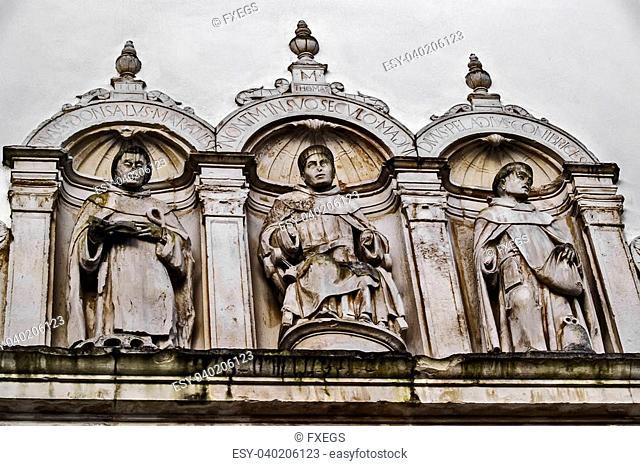 Coimbra, December 2012. Saint Salvador Church. Detail on the facade. Religous personalities, Saint Thomas in the middle