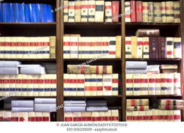 Bookshelf plenty of old legal books. Blurred background