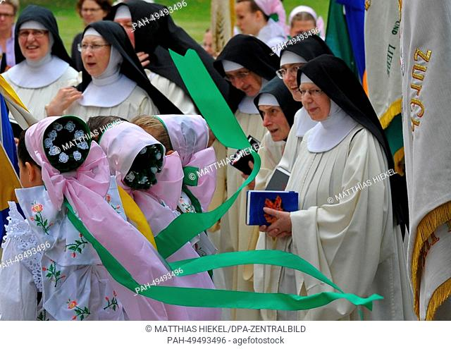 Catholic Sorbs in traditional dress and nuns of convent St. Marienstern during a Corpus Christi procession in Crostwitz, Germany, 19 June 2014