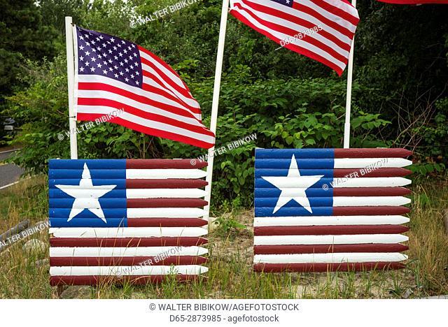 USA, Massachusetts, Cape Cod, West Yarmouth, US flag painted fence