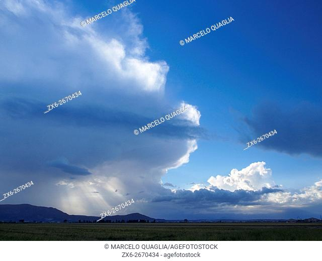 Stormy cloud formation over Montsia Hills and Ebro River Delta Natural Park. Tarragona province, Catalonia, Spain