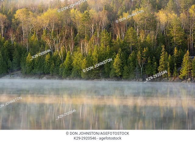 Early spring morning mists on Simon Lake, Greater Sudbury, Ontario, Canada