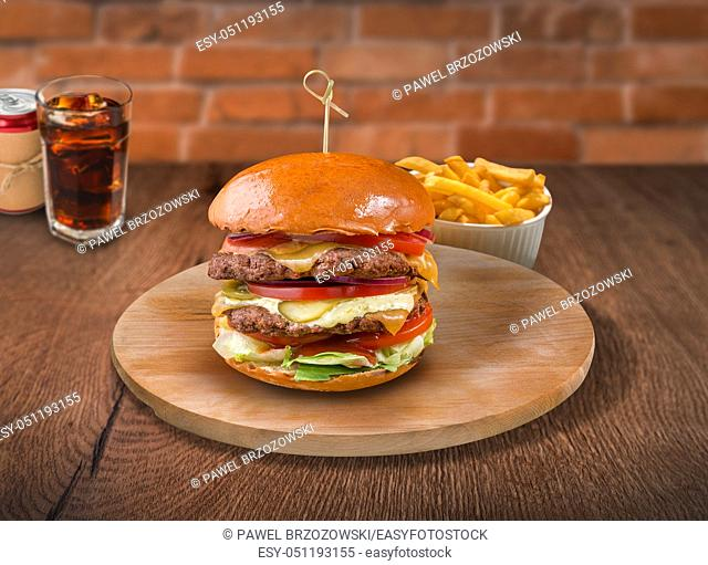 Beef burger on wooden background. For fast food restaurant design or fast food menu