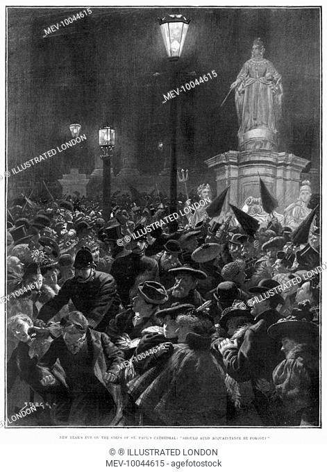 Celebrating New Year's Eve in London - police keeping order among the crowd gathered on the steps of Saint Paul's Cathedral