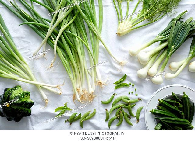 Fresh green vegetables on white tablecloth