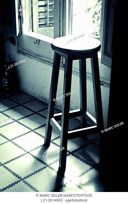 Stool in a room near a window