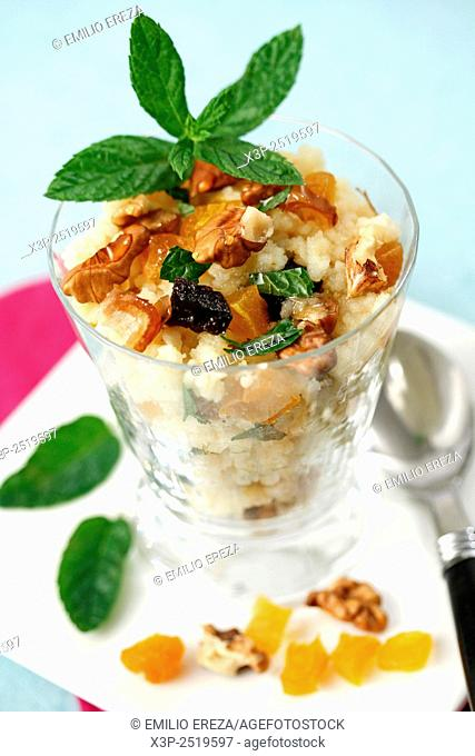 Couscous dessert with dried fruits.