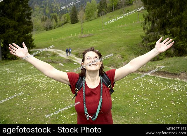 Happy mature woman in countryside. Bad Tölz, Upper bavaria, Germany