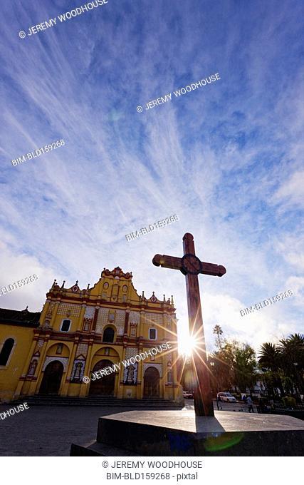 Cross and ornate church facade in town square, San Cristobal de las Casas, Chiapas, Mexico