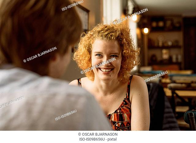 Couple on date in cafe smiling