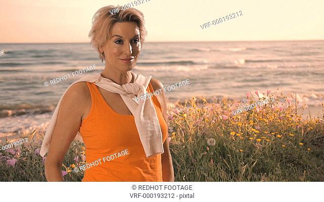 Woman standing by seashore