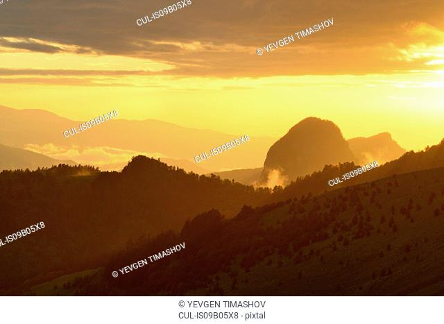 Golden silhouetted landscape at sunset, Bolshoy Thach (Big Thach) Nature Park, Caucasian Mountains, Republic of Adygea, Russia