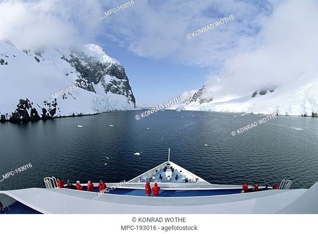 Ship with tourists in Lemaire Channel, Antarctica