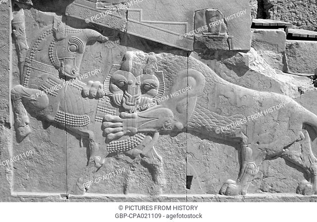 Iran / Persia: Representation of Angra Mainyu (Ahriman) killing the primeval bull. Persepolis, c. 4th century BCE