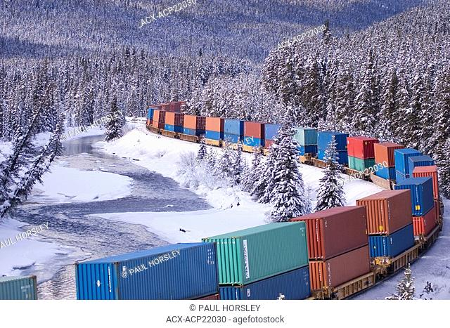 Container Train, Bow River and snow covered trees in winter. Banff National Park, Alberta