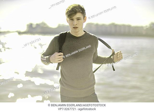 young model man at waterside, in Hamburg, Germany