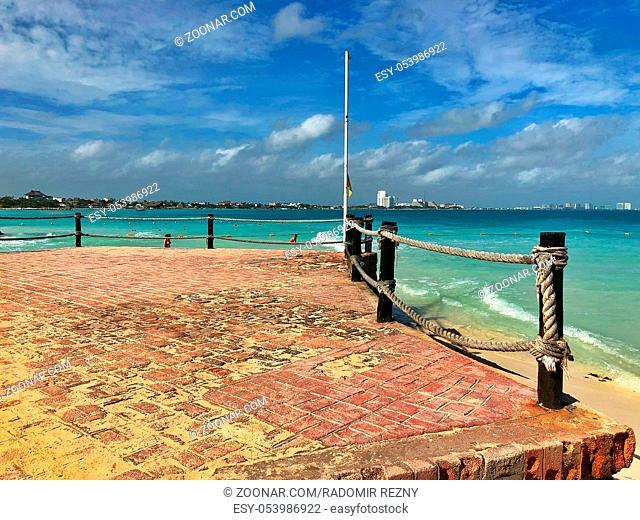 Old pier on the empty beach, Cancun, Yucatan, Mexico