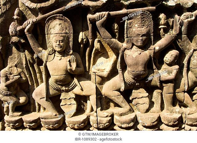 Detail of a carved bas relief, God sculptures, Terrace of the Elephants, Angkor Thom, UNESCO World Heritage Site, Siem Reap, Cambodia