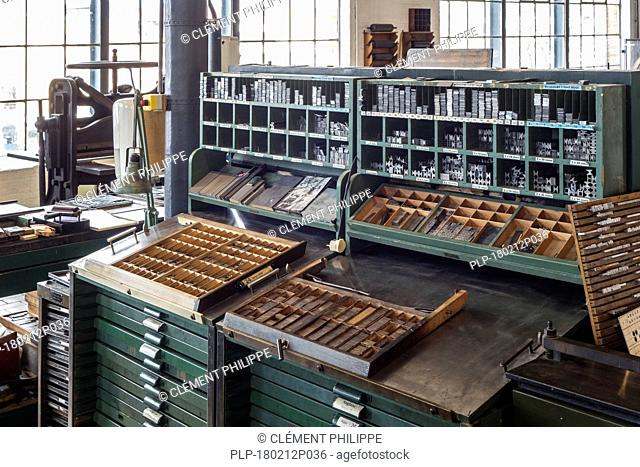Type case in composing room at printing business, technology for mechanical typesetting text in letterpress printing