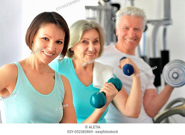Portrait of a family doing exercises, sport concept