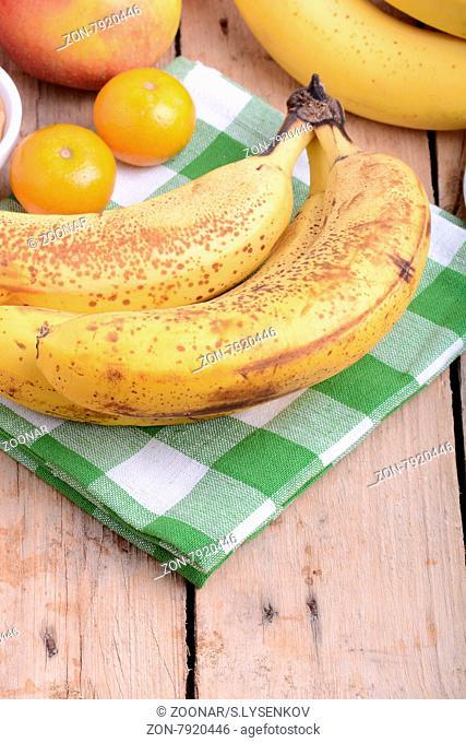 mandarin, bananas and apples, health fresh food close up