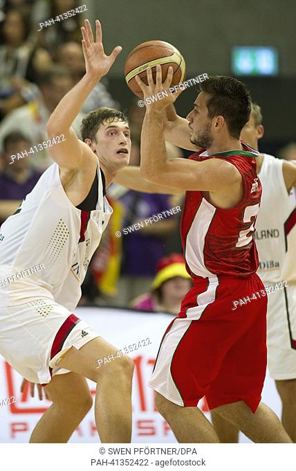Germany's Tibor Pleiss (L) plays against Portugal's Tomas Barroso during the international basketball match Germany vs. Portugal at S-Arena in Goettingen