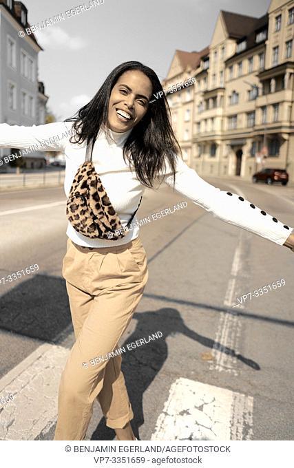 carefree woman at street