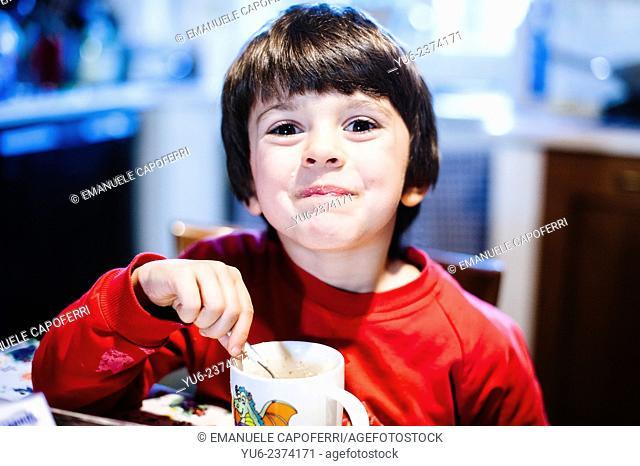 Child eats breakfast