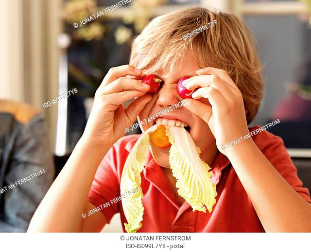 Boy playing with healthy food