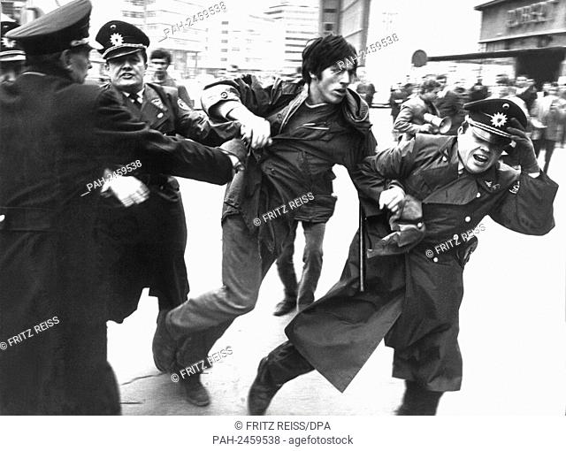 Policemen lead away a sutdent during a demonstration against Vietnam War on the 29th of March in 1969 in Stuttgart, who is accused of having thrown stones