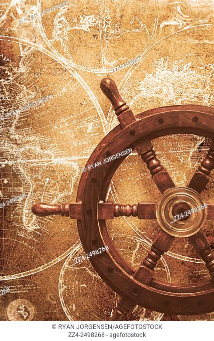 Creative photo composition of a ship helm on world navigation map, Nautical exploration