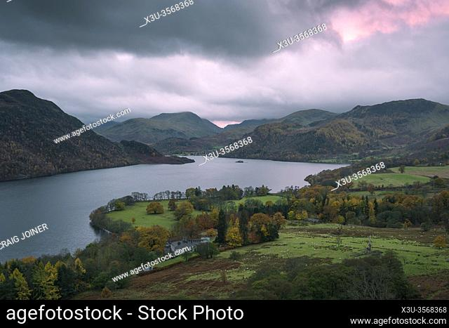 Autumnal evening view over Ullswater and Aira Point from Gowbarrow Fell in the Lake District National Park, Cumbria, England