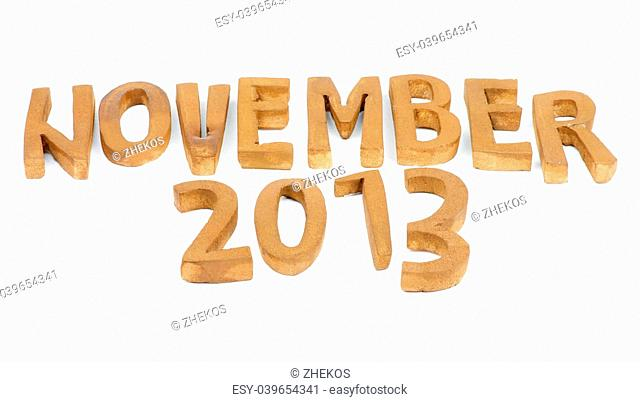 "Wooden Handmade Letters """"November 2013"""" isolated on white background"