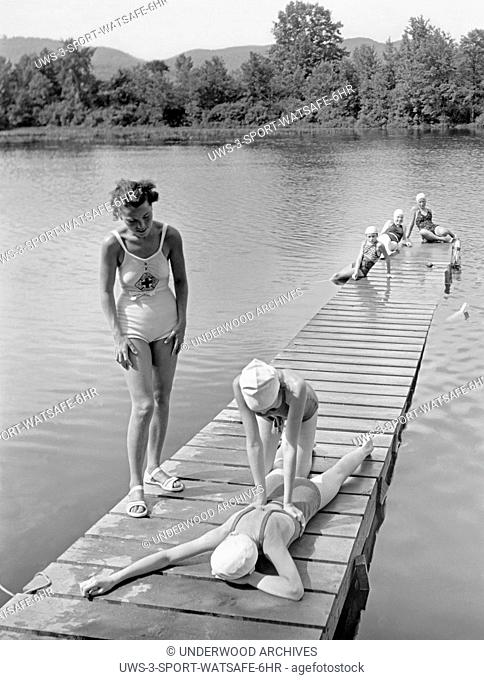 Hadley, Massachusetts: c. 1928 A Red Cross water safety instructor teaches artificial respiration at the Girl Scout's Camp Lewis Perkins