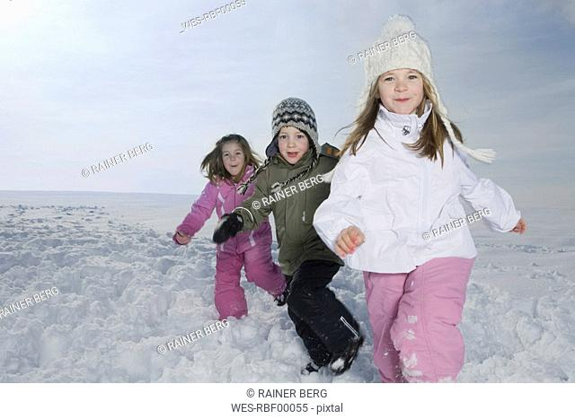 Germany, Bavaria, Munich, Children in snowy landscape