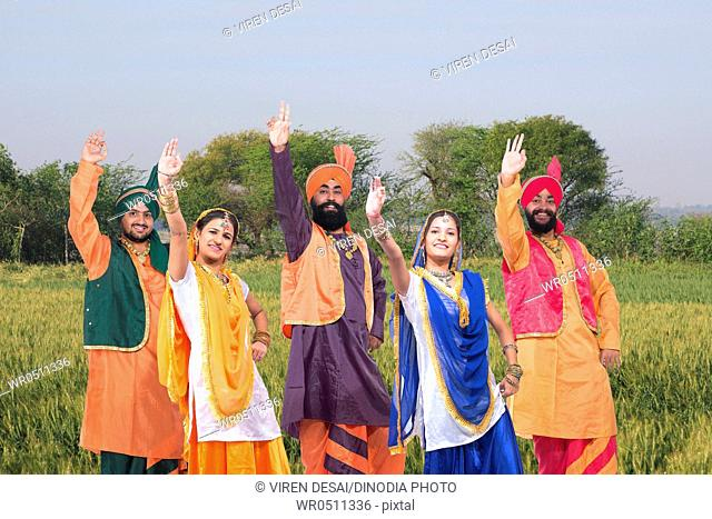 Dancers performing folk dance bhangra in field MR779F, 779E, 779C, 779D, 779B