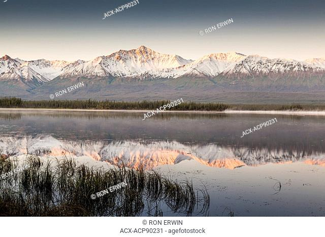 Snow dusted mountains in the Kluane Ranges of the St. Elias Mountains south of Beaver Creek, Yukon, Canada, along the Alaska Highway