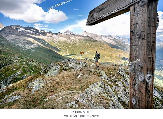 Switzerland, Valais, woman on a hiking trip in the mountains at Foggenhorn summit