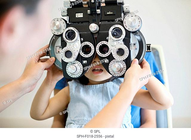 Girl having her eyes tested