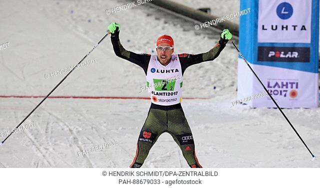 Johannes Rydzek from Germany celebrates the victory after the team sprint of the combination large hill/2 x 7.5 km team sprint event at the Nordic Ski World...