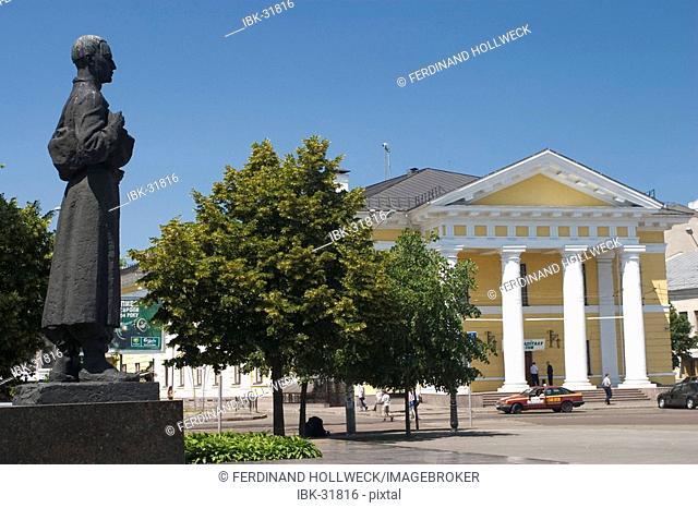 Ukraine Kiev district Podil Kontraktova Place oldest place of town view to the historical building of contrakts and the bronce statue of Hryhorij Skovoroda...