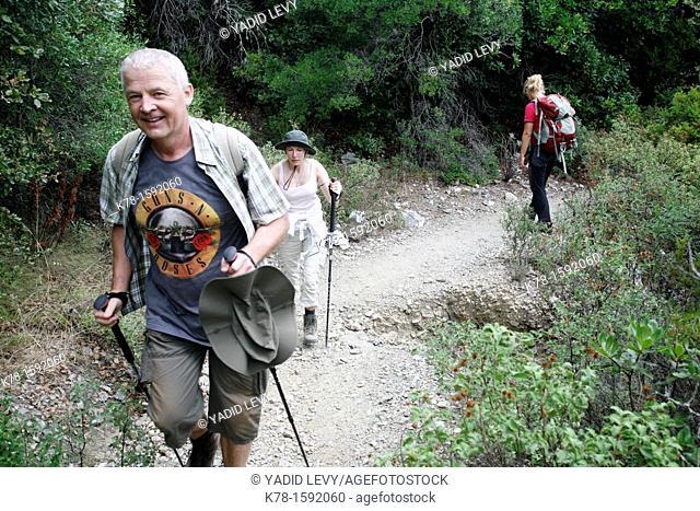 Hikers on the path to Gola Su Gorruppu canyon, Sardinia, Italy