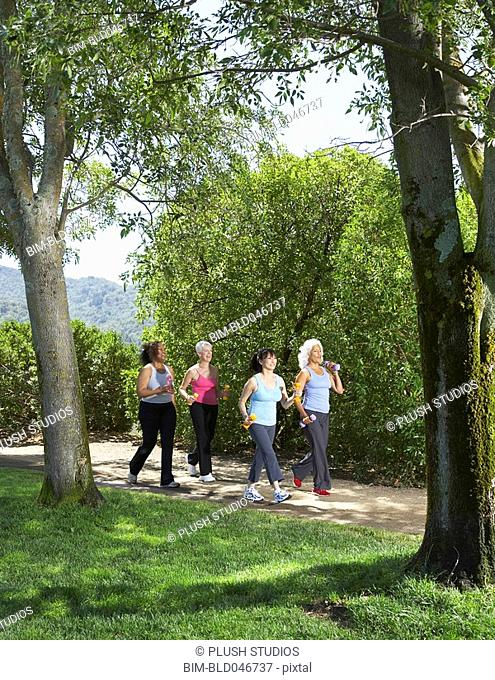 Multi-ethnic senior women walking in park