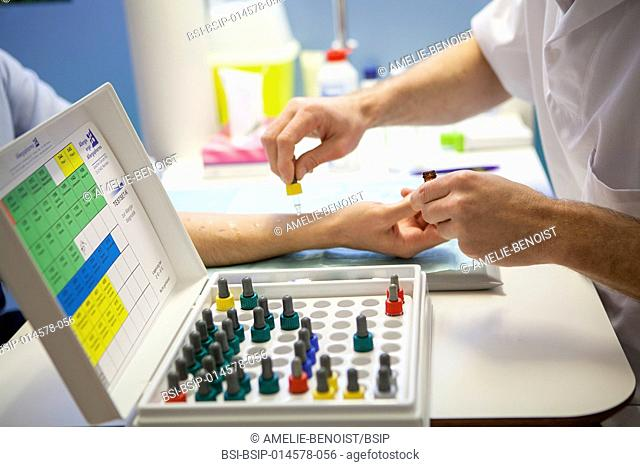 Reportage in an allergy specialist practice in Geneva. The allergy specialist carries out skin allergy tests by administering allergens on the upper part of the...