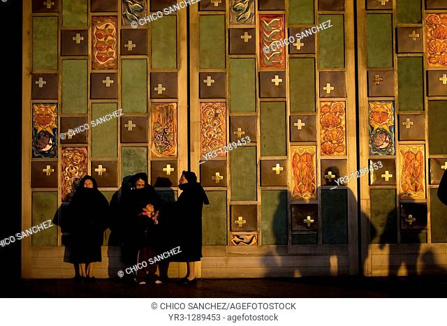 Nuns stand at the entrance of the Our Lady of Guadalupe Basilica in Mexico City, December 4, 2010  Hundreds of thousands of Mexican pilgrims converged on the...